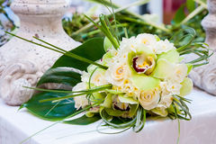 Wedding Bouquet. Bouquet of the roses of orchids on the table Stock Image