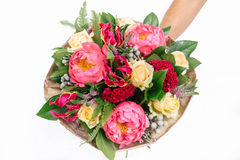 Bouquet with roses, peonies, celosia, brunia and veronica. On white background Stock Images