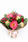 Bouquet with roses, peonies, celosia, brunia and veronica. On white background Royalty Free Stock Photos