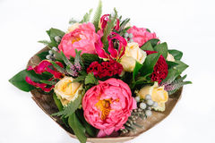 Bouquet with roses, peonies, celosia, brunia and veronica. On white background Stock Photo