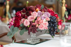 Bouquet of roses, peonies, grapes and pomegranates in the Dutch style Stock Images