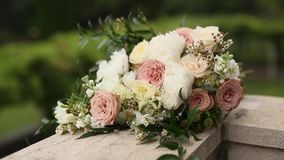Bouquet of roses and peonies lies on the balcony of the villa Mi. Locer, Montenegro stock footage