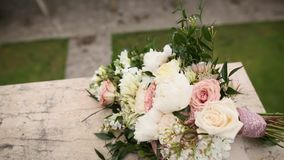 Bouquet of roses and peonies lies on the balcony of the villa Mi. Locer, Montenegro stock video