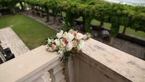 Bouquet of roses and peonies lies on the balcony of the villa Mi. Locer, Montenegro stock video footage