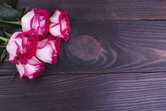Bouquet of roses and place for text. Pink roses on a wooden background. Surprise on the anniversary stock images