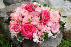 Bouquet of roses on rocks. Bouquet of roses and baby's breath outdoors on rocks Stock Photos