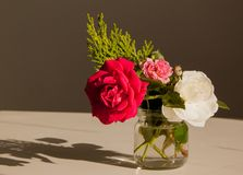 Bouquet of roses in small jar on the table royalty free stock image