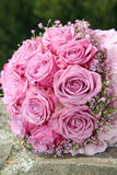 Bouquet of roses on stone. Pink roses on stone in the garden Stock Photos