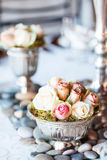 Bouquet of roses on table at wedding reception Stock Images