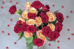 Bouquet of roses of two colors for beloved, many red hearts, top view, symbol of love,Valentine`s feast and romantic Stock Photos