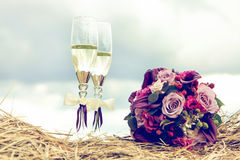 Bouquet of roses and two glasses of vine Stock Photos