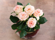 Bouquet of roses in a vase. On the floor Stock Photos