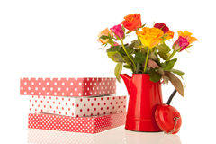 Bouquet roses in vase with gifts Royalty Free Stock Image