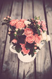 Bouquet of roses in vintage coffee pot Royalty Free Stock Photo