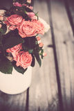 Bouquet of roses in vintage coffee pot Stock Photography