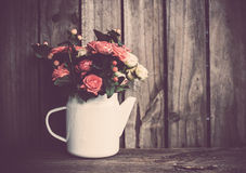 Bouquet of roses in vintage coffee pot Stock Images