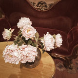 Bouquet of roses in a vintage interior Stock Photos