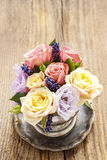 Bouquet of roses in vintage silver vase Royalty Free Stock Photography