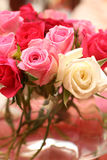 Bouquet of roses at the wedding. Small bouquet of red, white and pink roses in a vase at the wedding. Very shallow depth of field, macro shot Stock Photography