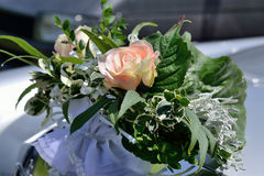 Bouquet of roses at wedding car Stock Image