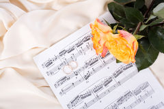 Bouquet of Roses, wedding rings on Silk Stock Images