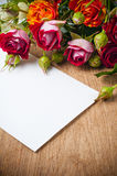 Bouquet of roses and white cardboard Royalty Free Stock Photos