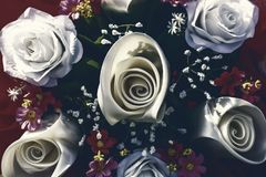 Bouquet roses in white color and red flower. Bouquet roses in white color and red flower in the park Royalty Free Stock Photo