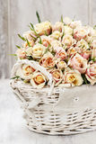 Bouquet of roses in wicker basket Royalty Free Stock Photos