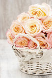 Bouquet of roses in wicker basket Stock Photo
