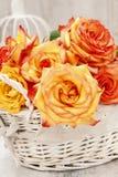 Bouquet of roses in wicker basket Stock Image