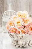 Bouquet of roses in wicker basket Stock Photography