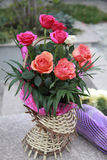 Bouquet of roses in wicker basket. Garden party decor Stock Images