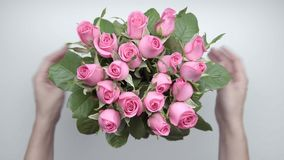 Bouquet of roses. 8. Women`s hands locate a bouquet of pink roses on the table. 8 stock footage