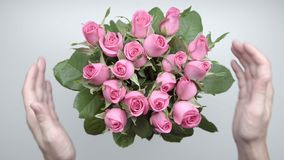 Bouquet of roses. 10. Women`s hands touch a bouquet of pink roses on the table. 10 stock video