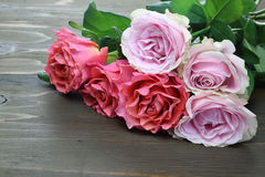 Bouquet of roses on a wooden background Royalty Free Stock Images