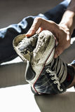 Torn sole sneakers, abstract poverty and misery Royalty Free Stock Images