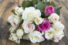 Bouquet of Roses on a Wooden Rustic Table Stock Image