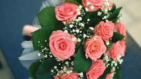 Bouquet of roses on wooden table stock video footage