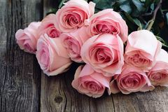 Bouquet of roses on wooden table. Bouquet of pink roses on old wooden table Royalty Free Stock Photos