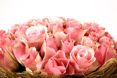Bouquet of roses wrapped in decorative straw. background Royalty Free Stock Image