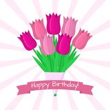 Bouquet of seven pink tulips against a background of rays. Pink ribbon with a birthday. Bouquet of seven beautiful pink tulips against a background of rays Royalty Free Stock Photos