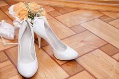 Bouquet and shoes Stock Photography