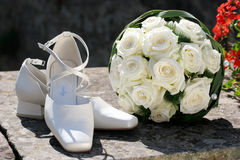 Bouquet an shoes. Bride's bouquet and shoes, wedding concept Royalty Free Stock Images