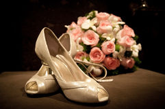 Bouquet an shoes of bride Stock Photo