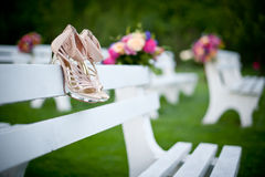 Bouquet and Shoes - Flowers for a wedding. Wedding shoes in white was on the bench Stock Images