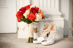 Bouquet and shoes in front of church Royalty Free Stock Photo