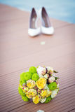 Bouquet and shoes Royalty Free Stock Images