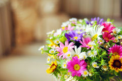 Bouquet of simple flowers. On the table Royalty Free Stock Photos