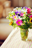 Bouquet of simple flowers. On the table Stock Images