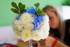 Bouquet of simple flowers on the table. Florist making wedding flower decoration Royalty Free Stock Images